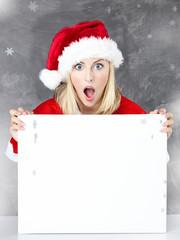 Surprised santa presenting white message board