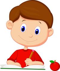 Cute boy writing on a book