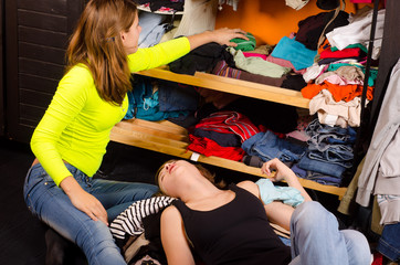 Teenage girls choosing clothes