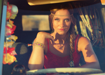 attractive brunette woman driving an old car