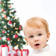 happy little boy with christmas tree and gifts