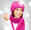 woman in hat and muffler with big snowflake