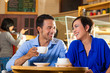 Asian woman and man in an coffee shop