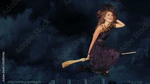 Witch woman flying on broomstick.