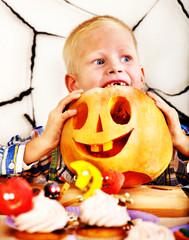 Child holding Halloween pumpkin carving .