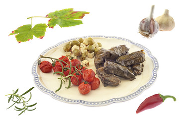 Vine leaves with olives, greek cheese and vegetables