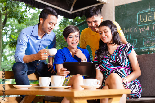 Group of young people in an Asian coffee shop