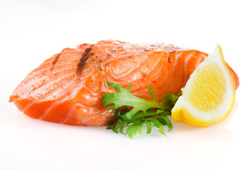 Grilled salmon with lemon on white background