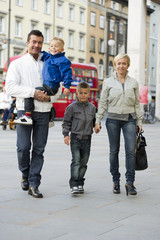 Family walking in London street