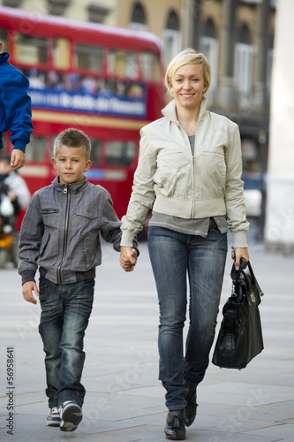 Mother and son walking in London street