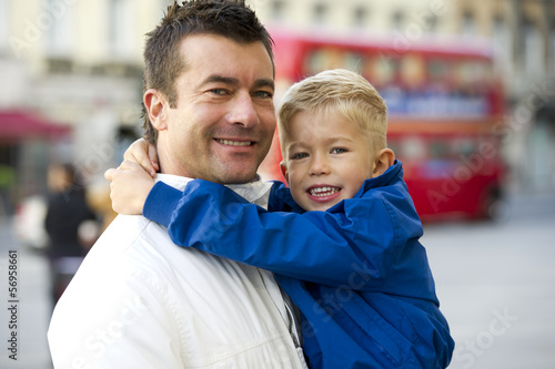 Father holding son in London street