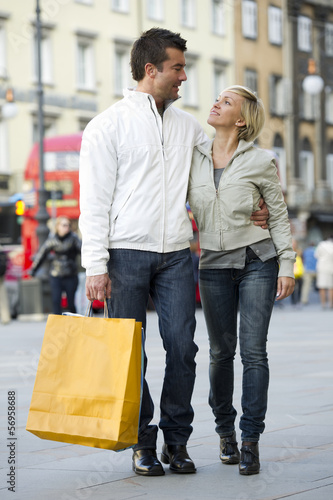 Young couple in street with shopping bags