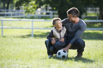 Father and son playing together in the park