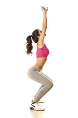 pretty and attractive girl doing exercises on white background