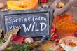 Leinwandbild Motiv Spezialitäten vom Wild - Aufsteller und Tischdeko im Herbst