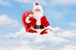 Santa Claus sitting on clouds with bag and flying