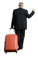 businessman with suitcase is hiking