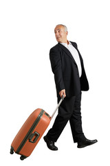 man with suitcase looking back and smiling