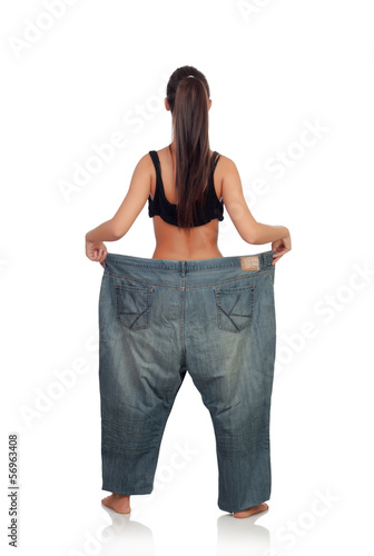 Slim woman back with huge pants