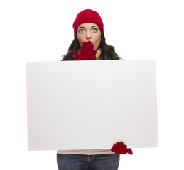 Stunned Girl Wearing Winter Hat and Gloves Holds Blank Sign