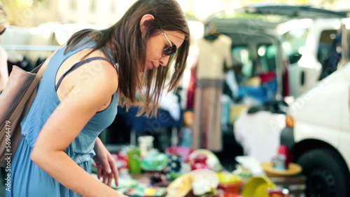 Young beautiful woman on flea market