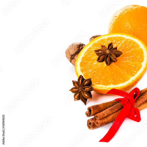 Anise star, Cinnamon stick and fresh orange, Christmas spices f