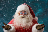 Fototapety Santa Claus wearing sunglasses dancing outdoors at North Pole