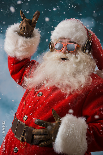 Santa Claus is listening to music in headphones outdoors at Nort