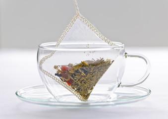 Herbal tea bag in glass cup