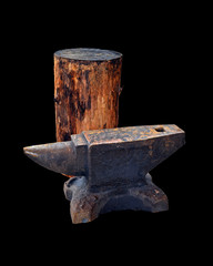 Isolated blacksmith anvil and wooden deck