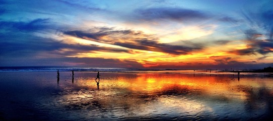 Beach sunset reflection