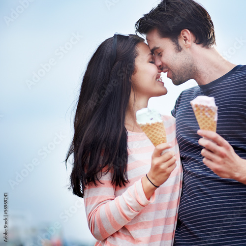 romantic couple face to face with ice cream