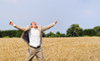 Happy young person shouting in the wheat field