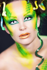 fashion portrait woman with creative make up like a snake