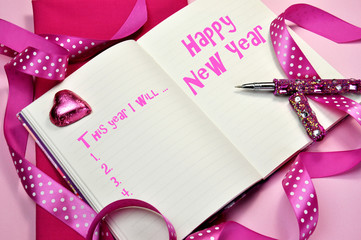 Pink Happy New Year resolutions in diary journal book