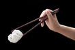 Chinese steamed barbecue pork bun with chopsticks (Dim Sum)