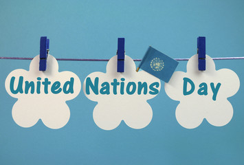 United Nations Day message written across pegs on a line