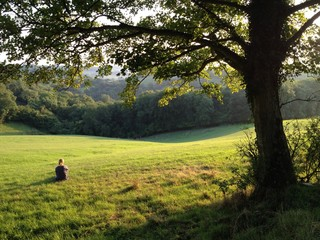 One woman sitting looking at beautiful countryside