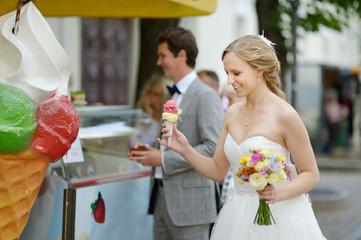 Bride and groom having an ice cream
