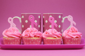 Four Pink cupcakes with Pink Ribbon symbols