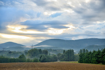 Early morning in south France with clouds and myst