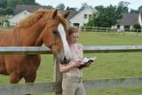 Student studying Holy Bible on Farm with Horses