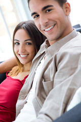 Portrait of happy young couple looking at the camera