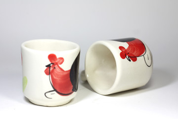 Tea cup with chicken pattern
