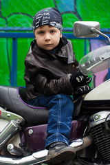 Young biker on a motorcycle
