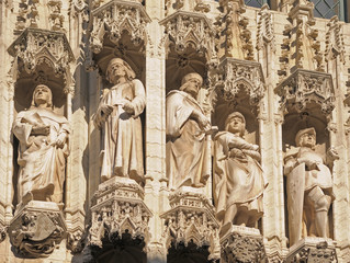 Gothic statues on facade of medieval city hall