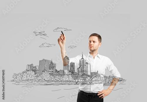 man drawing city
