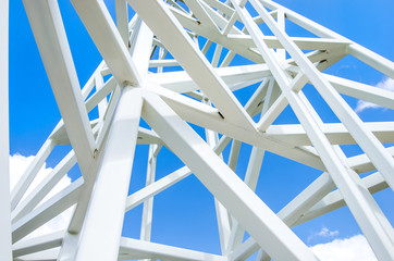 Close up on white steel tower on blue sky background