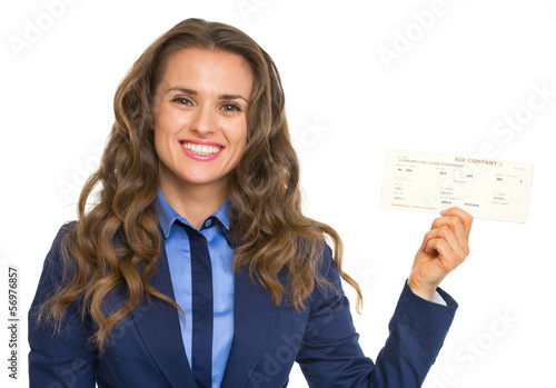 Smiling business woman showing air tickets