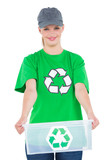 Pleased environmental activist holding a recycling box